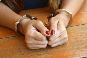 Female hands in cuffs
